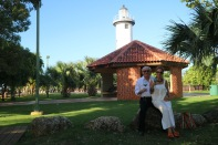 This couple was celebrating their recent marriage. They were highschool sweethearts and had not seen each other until recently. So they decided to get married and were celebrating next to this lighthouse.